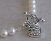 Swarovski white pearl necklace with crystal studded heart toggle clasp