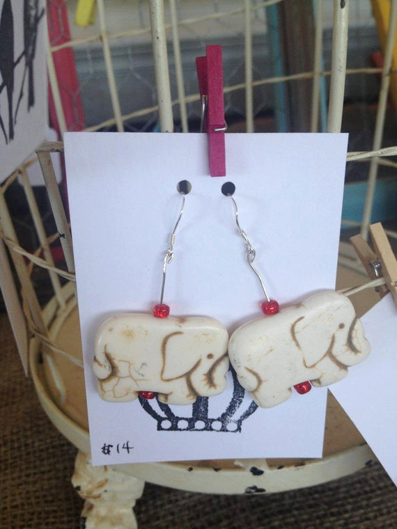 white elephant sterling silver dangling earrings with 2 red beads.