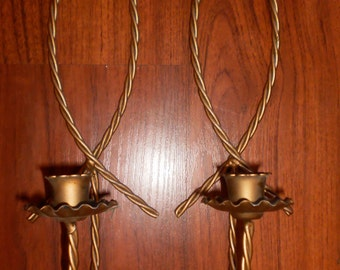 Brass set of taper candle holders. (western look)
