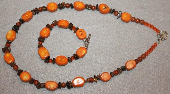 Orange bamboo coral necklace and bracelet set.