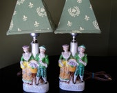 Vintage Lamps Pair signed Japan porcelain ceramic figural of man and woman French style in sage green aqua and yellows with shade
