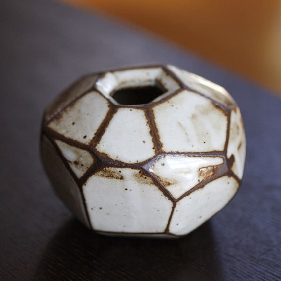 Faceted brown and white vase.