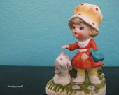Vintage Little girl with orange bonnet and puppy Unmarked Homco