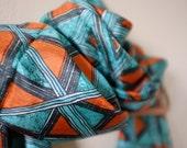 Geometric orange and teal silk scarf
