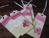 A great set of five green and pink handmade sweet paper gift tags