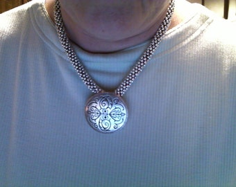 Silver tone crochet necklace with pendant