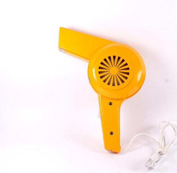 Retro orange hairdryer.
