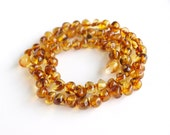 Elegant Baltic amber necklace. Honey color amber beads