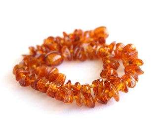Baltic amber baby teething necklace. Cognac color.