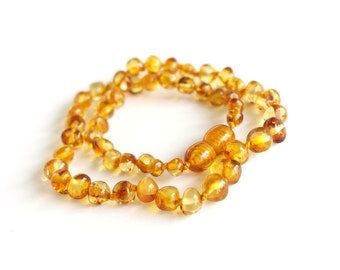 Baltic amber baby teething necklace. Honey color.