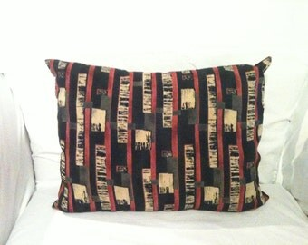 SILK 12x16 Accent Pillow patterned with wine colored stripes and tan, black and brown rectangles