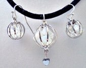 Caged moonstone and hematite pendant and earring set - jewelry set