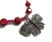 Dragons Blood gemstone and Antique Butterfly necklace