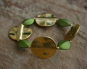 Gold plated flat round metal and lime green beaded bracelet