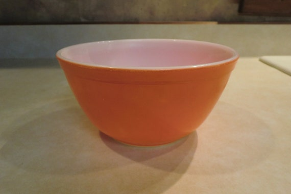 Bright orange Pyrex mixing bowl