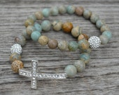 Set of two aqua terra jasper beaded gemstone stretch bracelets with pave crystal beads and a silver crystal cross.