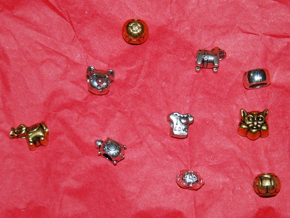 Ten 10 silver and gold charms for European bracelets and Pandora bracelets.