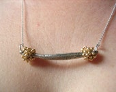 Silver and gold seed pod necklace