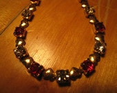Gold Heart Shaped Necklace with Red and White Rhinestone.
