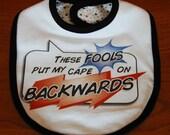 Baby Bib - These Fools Put My Cape On Backwards