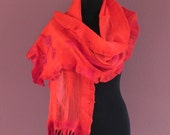 Red nuno felted scarf.