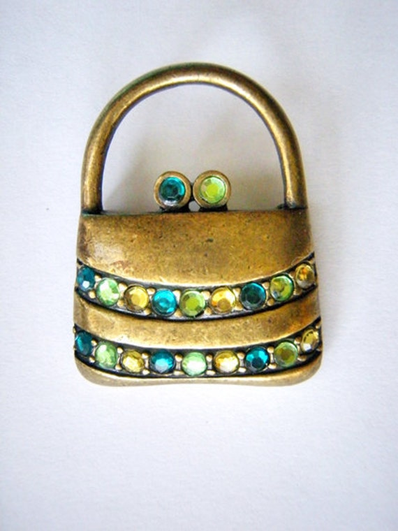 Vintage brooch with green stones