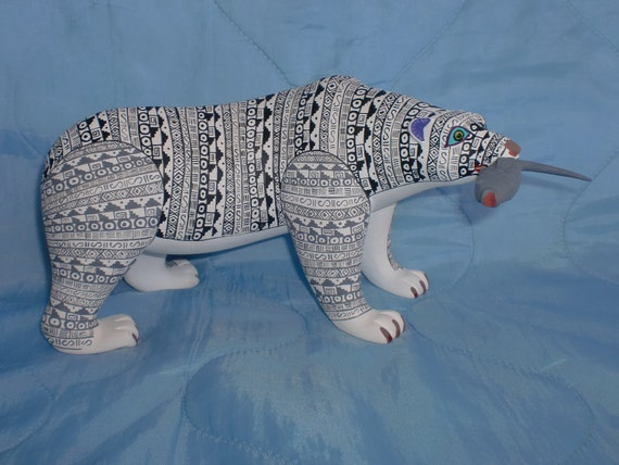 brightly painted wooden polar bear