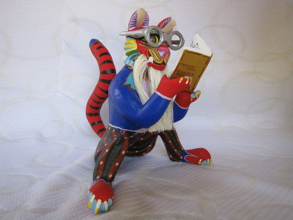 brightly painted wooden wise cat