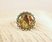 Adjustable ring with picture of birds, vintage style