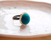 Handmade Needle felted ring. Pine green wool on Antique Bronze Plated Adjustable Ring , surrounded by shiny Creamy Japanese TOHO beads.