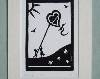 Print - 'Let's go fly...' Black and white print of two people flying a heart-shaped kite.