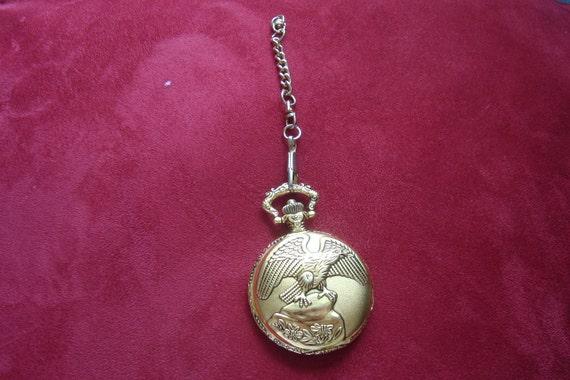 Item is on Sale.     Puritan Pocket Watch Goldtone Eagle Etched Back Floral Working, Japan Movement.