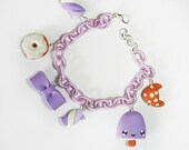 Violet bracelet with marshmallow, a bow, a croissant, a popsicle and a donut, with cotton bracelet, all made in fimo/polymer clay