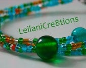 Aqua & Green Bracelet: 3 Strand Glass Bracelet with Orange and Sparkly White Accents