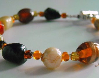 Autumn Glory: Brown, Tan, Amber, Black, Orange single strand glass bead bracelet