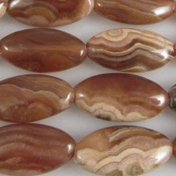 12 Rhodocrosite brown Peruvian long oval marquise beads 16 to 17mm Code 0095