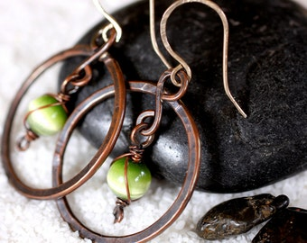Hammered Reclaimed Copper Circle Earrings with Dangling Green Optic Bead