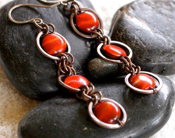 Cascading Saturn-Ring Copper Earrings with Marbled Orange Beads