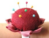 One red felt flower wrist pincushion
