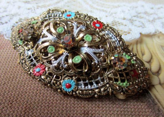 vintage filigree brooch with painted flowers and rhinestones