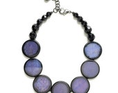 Purple and black disk and crystal necklace and earrings