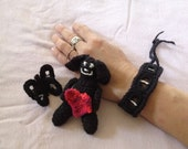 Crochet Set of Black Butterfly Pin, Black Cuff Bracelet, and a Black Dog Doll w/ a Red Heart