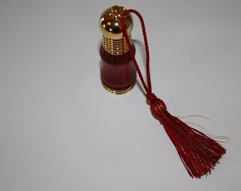 Hand turned bloodwood perfume atomizer with 24k Gold plated accents