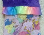 Gorgeous baby blanket. Satin ruffle trim Disney princess and minky baby blanket.