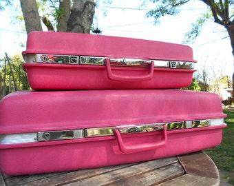 hot pink Saturn Samsonite luggage