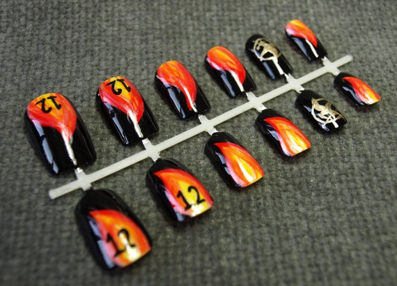 Hunger Games Nails. Hand Painted Nail Art Set. Girl on Fire, Mockingjay, District 12.