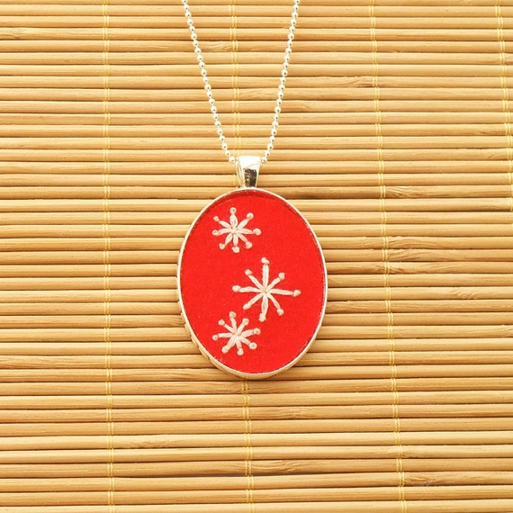 Mod Stars hand embroidered pendant or keychain in red-orange