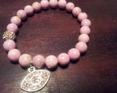 Pink Riverstone Bracelet with Pink Crystal Eye Charm