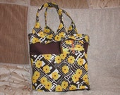Modern Floral design diaper bag and matching travel wipe case.