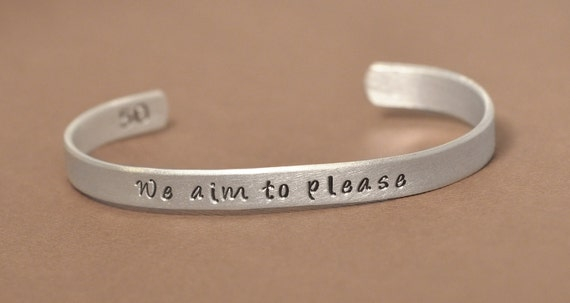 50 Shades of Grey inspired hand stamped bracelet - We aim to please